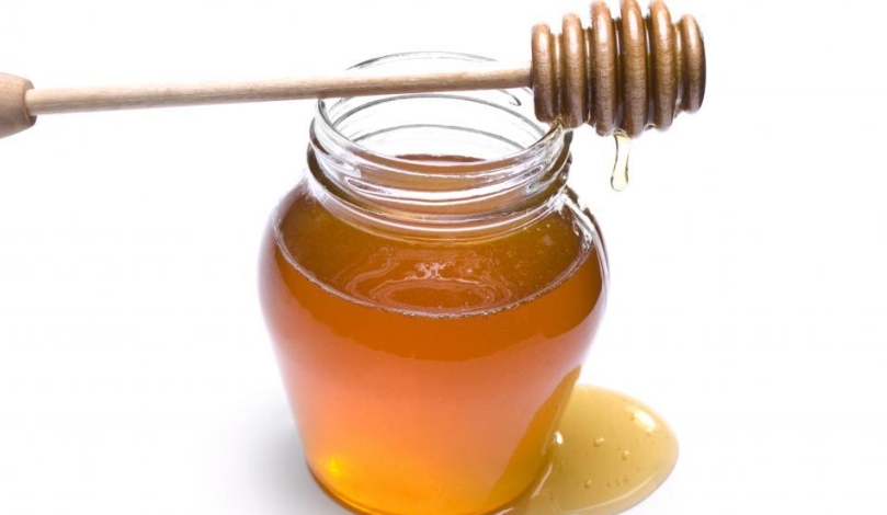 honey-has-been-consumed-for-thousands-of-years-for-its-supposed-health-benefits-jar-of-honey-with-wooden-dipper-on-top-dripping-honey.jpg